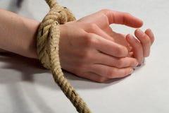 Mão amarrada Fotos de Stock Royalty Free