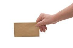 Mão & envelope pequeno Fotografia de Stock