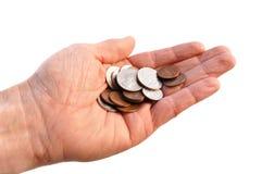 Mão colocada que prende moedas americanas Foto de Stock