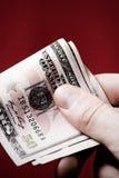 Mão com 50 dólares Fotografia de Stock