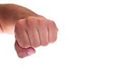 A mão com apertou um punho Foto de Stock
