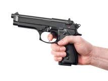 Mão com arma Fotos de Stock