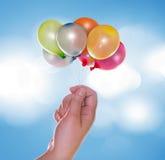 Mão com balões Imagem de Stock Royalty Free