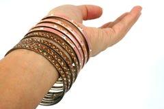 Mão com braceletes Imagens de Stock