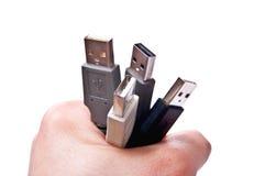 Mão com cabos Foto de Stock Royalty Free