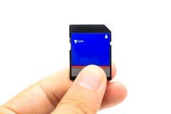 Mão com cartão do SD Fotos de Stock