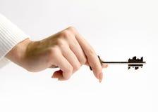 Mão com chave Fotos de Stock
