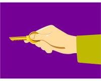 Mão com chave Imagem de Stock Royalty Free