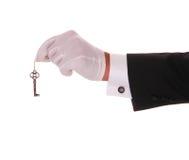 Mão com chave Imagens de Stock Royalty Free