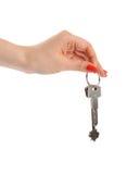 Mão com chave Fotografia de Stock