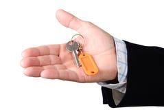 Mão com chave Fotografia de Stock Royalty Free