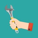 Mão com chave de macaco Fotografia de Stock