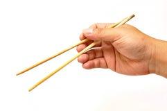 Mão com chopsticks Foto de Stock Royalty Free