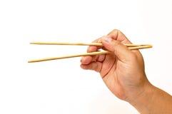 Mão com chopsticks Fotos de Stock Royalty Free