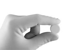 Mão com comprimido Fotografia de Stock