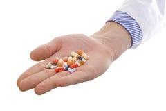 Mão com comprimidos Imagem de Stock