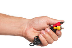 Mão com conectores de cabo foto de stock royalty free