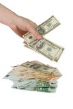Mão com contas de dólar Fotos de Stock
