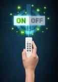 Mão com controlo a distância e -fora em sinais Foto de Stock Royalty Free