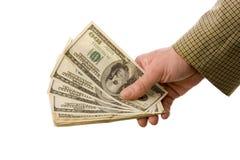 Mão com dólares Fotografia de Stock Royalty Free
