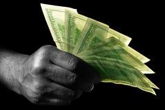 Mão com dólares Fotografia de Stock