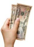 Mão com dólares imagens de stock royalty free