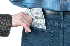 Mão com dólares no bolso traseiro Fotografia de Stock Royalty Free