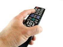 Mão com de controle remoto Fotografia de Stock Royalty Free