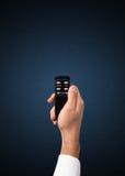 Mão com de controle remoto Foto de Stock Royalty Free