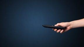 Mão com de controle remoto Fotos de Stock