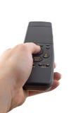 Mão com de controle remoto fechado Fotos de Stock Royalty Free