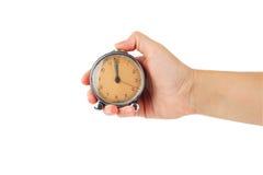 Mão com despertador Fotos de Stock Royalty Free