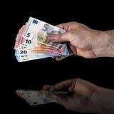 Mão com dinheiro Fotografia de Stock