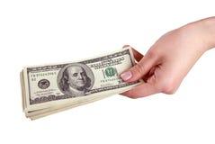 Mão com dinheiro no fundo branco (isolado) fotografia de stock