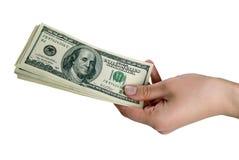 Mão com dinheiro no fundo isolado Fotos de Stock