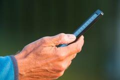 Mão com ebook Imagem de Stock