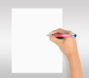 Mão com escrita da pena no Livro Branco Imagem de Stock