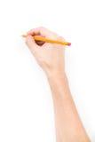 Mão com escrita do lápis algo Foto de Stock