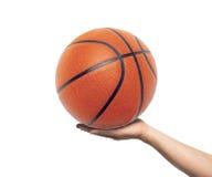 Mão com esfera do basquetebol Imagens de Stock