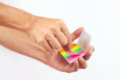 Mão com etiquetas coloridas no fundo branco Imagem de Stock Royalty Free