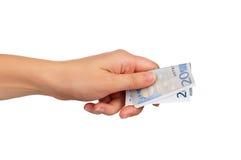 Mão com euro Imagem de Stock Royalty Free
