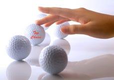 Mão com golf-ball Imagens de Stock