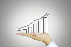 Mão com gráfico de negócio Foto de Stock Royalty Free