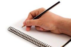 Mão com lápis imagens de stock