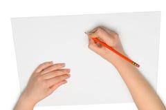 Mão com lápis vermelho Imagem de Stock