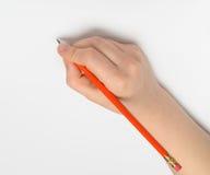 Mão com lápis vermelho Fotografia de Stock