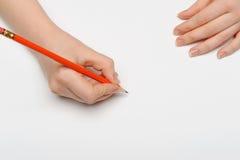 Mão com lápis vermelho Imagens de Stock Royalty Free