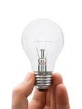 Mão com lâmpada Fotografia de Stock Royalty Free