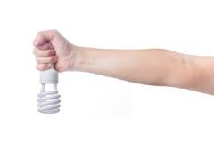 Mão com a lâmpada de poupança de energia no fundo branco Fotografia de Stock Royalty Free