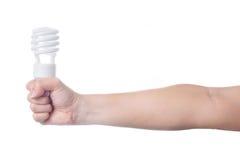 Mão com a lâmpada de poupança de energia no fundo branco Imagens de Stock Royalty Free